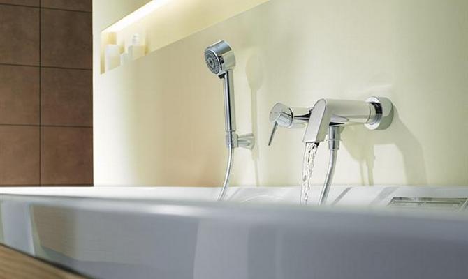 Конструктивные характеристики смесителей для ванной с душем: переключатель направления воды